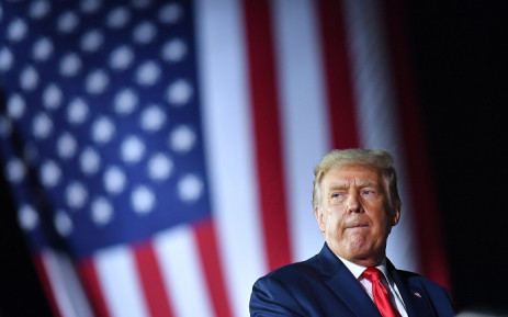 FILE: US President Donald Trump addresses supporters during a campaign rally at MBS International Airport in Freeland, Michigan on 10 September 2020. Picture: AFP.