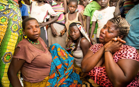 A Congolese mother (R) reacts after her toddler died - allegedly from a Cholera outbreak - at a refugee settlement in Kyangwali, Uganda, on 16 February 2018. Picture: AFP