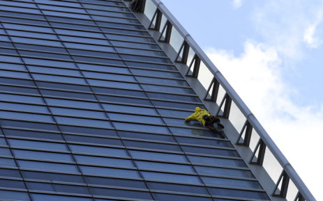 Alain Robert, the French urban climber dubbed Spiderman, climbs French Energy group Engie's building in the La Defense business district outside Paris on 25 March 2019. Picture: AFP