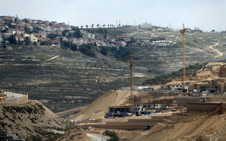 FILE: Workers and bulldozers work at a construction site in the Israeli settlement of Givat Zeev near the West Bank city of Ramallah. Picture: AFP.