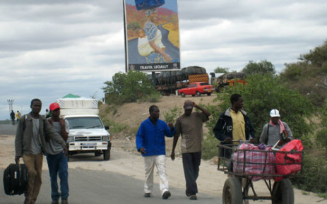 Zimbabwean shoppers return to their home town Beitbridge after Christmas shopping in South African border town of Musina. Picture: AFP