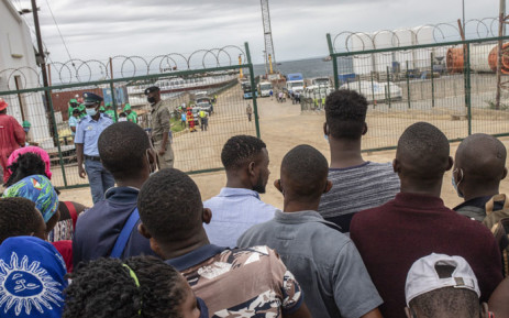People wait for their relatives and friends to arrive in Pemba on 1 April 2021, from the boat of evacuees from the coasts of Palma. More than 1,000 people evacuated from the shores of the town of Palma arrived at the sea port of Pemba after insurgents attacked Palma on 24 March 2021. Picture: Alfredo Zuniga/AFP