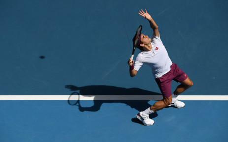 Switzerland's Roger Federer hits a return against Tennys Sandgren of the US during their men's singles quarter-final match on day nine of the Australian Open tennis tournament in Melbourne on 28 January 2020. Picture: @AustralianOpen/Twitter