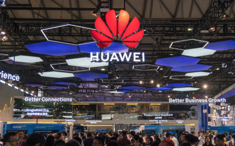 FILE: People gather at the Huawei stand during the Mobile World Conference in Shanghai on 27 June 2018. Picture: AFP