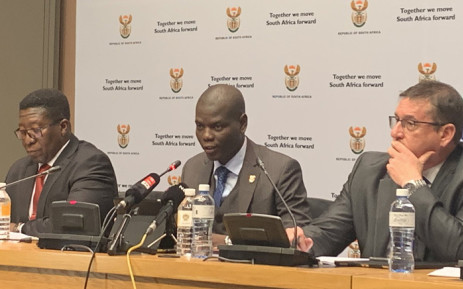 Justice and Correctional Services Minister Ronald Lamola (centre) briefing the media on 17 July 2019 ahead of tabling his department's budget. Picture: @SAgovnews/Twitter.