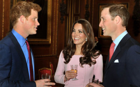 Britain's Prince William (R) talks with his wife Catherine, Duchess of Cambridge (C) and his brother Prince Harry (L) during a reception before Queen Elizabeth II's Sovereign Monarchs Jubilee lunch at Windsor Castle. Picture: AFP