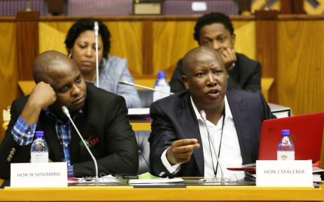FILE:EFF leader Julius Malema makes his representation to Parliament's powers and privileges committee in Cape Town, Tuesday, 7 October 2014. Also pictured is Floyd Shivambu (L). Picture: Sapa.