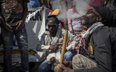 Rastafarians smoke cannabis outside the South African Constitutional Court on 18 September 2018, before the ruling on the private use marijuana is delivered. Picture: Thomas Holder/EWN