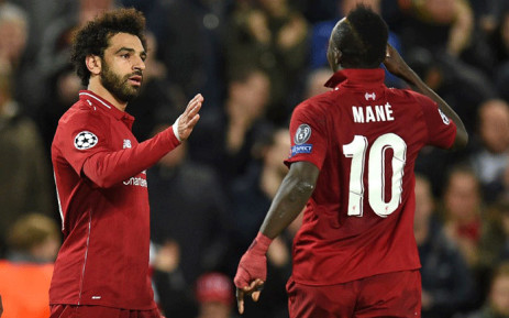 Liverpool's Egyptian midfielder Mohamed Salah celebrates with Liverpool's Senegalese striker Sadio Mane after scoring their second goal during the Uefa Champions League group C football match between Liverpool and Red Star Belgrade at Anfield in Liverpool, north west England on 24 October, 2018. Picture: AFP.
