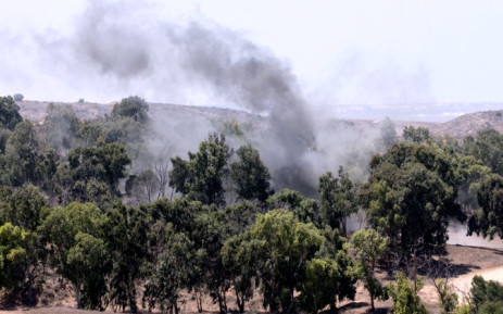A picture taken from the southern Israeli border with the Gaza Strip shows smoke rising from the remains of a mortar fired by Palestinian militants into Israel on 22 August 2014. Picture: AFP.