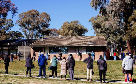 Residents queue up outside a COVID-19 testing center on the first day of the seven-day lockdown in Canberra, Australia, on August, 13, 2021. Picture: Jamila Toderas / AFP