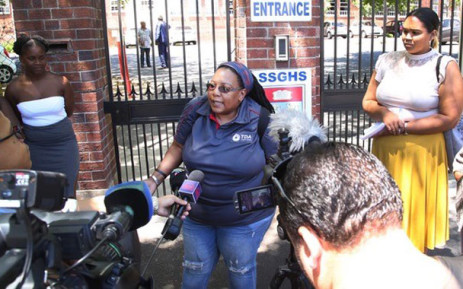 The mother of a Sans Souci Girls' High School learner addresses the media a day after her daughter was slapped by one of her teachers. Picture: Bertram Malgas/EWN