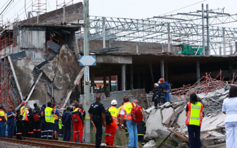 FILE: Rescuers search for construction workers still unaccounted for under the rubble at the Tongaat Mall. Picture: AFP.