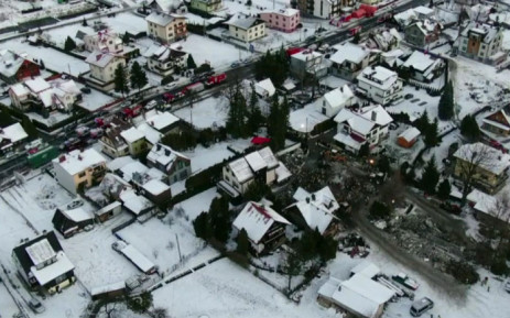 FILE: This television grab taken from Poland's TVN24 news channel shows rescuers working in the debris of a house destroyed by a gas explosion in Szczyrk, south Poland, on 4 December 2019. Picture: AFP