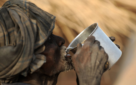 An Indian labourer quenches his thirst as he battles the countrys worst heatwave enveloping India with mid-summer temperatures rising above 48.6 degrees Celsius. Picture: AFP.