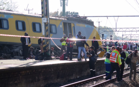 Paramedics and emergency services rush to help those trapped inside the two trains that collided at Denver Station, south east of Johannesburg on 28 April 2015. Picture: Louise McAuliffe/EWN.