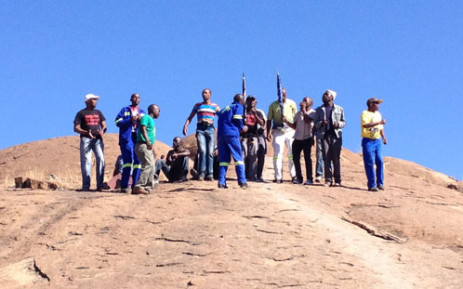 FILE: Miners gather on the koppie in Marikana ahead of the anniversary of the shooting. Picture: Christa Eybers/EWN.