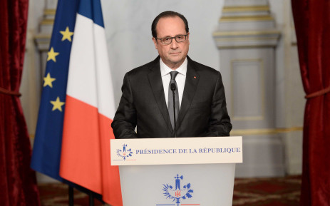"""French president Francois Hollande speaks in Paris on November 14, 2015, following a series of coordinated attacks in and around Paris late Friday which left more than 120 people dead. Hollande on Saturday blamed the Islamic State group for the attacks in Paris that left at least 128 dead, calling them an """"act of war"""".  Picture: AFP"""