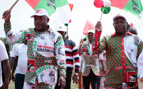 Burundi's incumbent president Pierre Nkurunziza (L) and Evariste Ndayishimiye, presidential candidate of the ruling party, the National Council for the Defense of Democracy - Forces for the Defense of Democracy (CNDD-FDD), react to supporters during the last day of their campaign in Bujumbura, Burundi, on 16 May 2020, ahead of the presidential and general election scheduled for 20 May 2020 despite the coronavirus pandemic. Picture: AFP