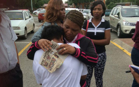 Three-year-old Cuburne van Wyk's mother Lezell being comforted outside court following another postponement in his murder case on 17 December 2014. Picture: Thando Kubheka/EWN.