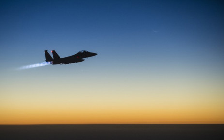 FILE: A US Air Force F-15E Strike Eagle flying over northern Iraq early in the morning of 23 September, 2014 after conducting airstrikes in Syria. These aircraft were part of a large coalition strike package that was the first to strike ISIL targets in Syria. Picture: AFP.