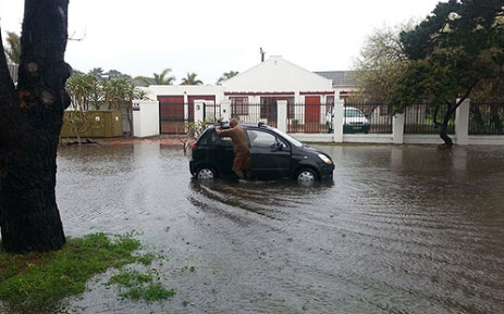 A man pushes a car in a flooded road in Edgemead, Cape Town on 28 August 2013. Picture: Glen De Goede.