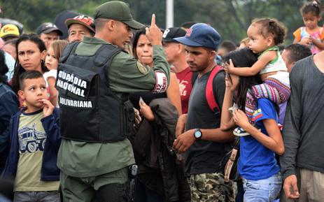 Venezuelan citizens cross the Simon Bolivar international bridge from San Antonio del Tachira in Venezuela to Norte de Santander province of Colombia on February 10, 2018. Picture: AFP.