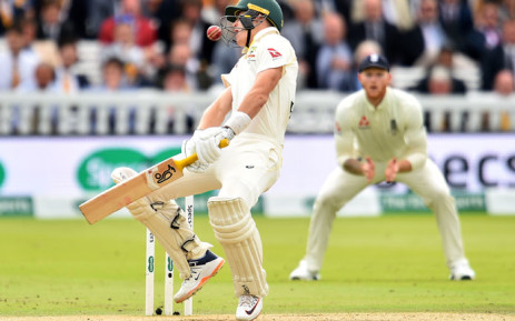 Australia's Marnus Labuschagne reacts as the ball, bowled by England's Jofra Archer (unseen), hits him on the helmet during play on the fifth day of the second Ashes cricket Test match between England and Australia at Lord's Cricket Ground in London on 18 August 2019. Picture: AFP
