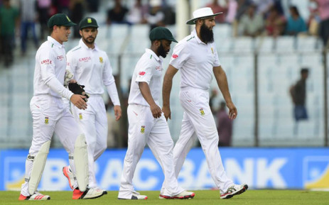 FILE: South African captain Hashim Amla (R) and cricketers Temba Bavuma (2R), Quinton de Kock (L) and Jean-Paul Duminy (2L) . Picture: AFP.