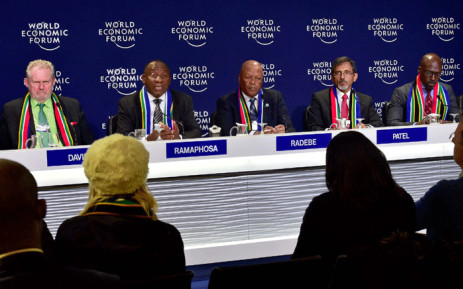 Deputy President Cyril Ramaphosa, flanked by ministers Rob Davies, Jeff Radebe, Ebrahim Patel and Malusi Gigaba, addresses a media conference at the end of his engagements at the World Economic Forum 2018 annual meeting in Davos, Switzerland. Picture: GCIS