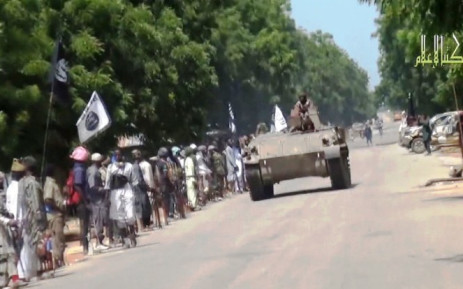 FILE: This screengrab shows Boko Haram fighters parading on a tank in an unidentified town. Picture: AFP.