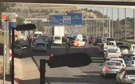 Police secure the area following a shootout on the N1 South near Nasrec on 8 October 2019. Picture: Intelligence Bureau SA
