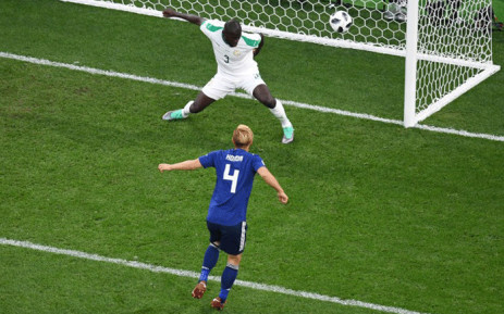 Japan's midfielder Keisuke Honda (4) scores his team's second goal during the Russia 2018 World Cup Group H football match between Japan and Senegal at the Ekaterinburg Arena in Ekaterinburg on 24 June, 2018. Picture: AFP.