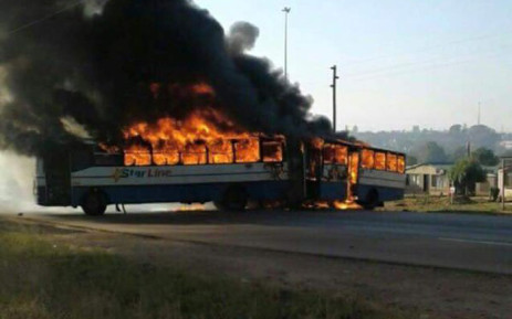 A bus was set alight and roads blocked in Hammanskraal following service delivery protests in the area. There were also reports of overnight violent demonstrations on 23 May 2016. Picture: Arrive Alive.