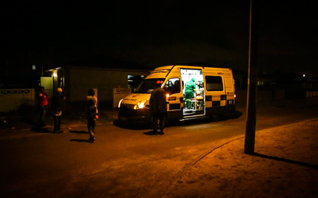 A Metro EMS ambulance is parked outside a patient's house while the man is being treated. Picture: Anthony Molyneaux/EWN