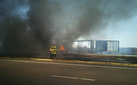 Firefighters attending the blaze at the scene of a multi-vehicle pile-up on the N1 between the Petroport and Walmansthal. Picture: @_ArriveAlive/Twitter