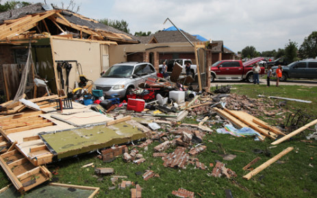 A family van is exposed after the garage was blown apart May 16, 2013 in Cleburne, Texas. A mile-wide tornado passed through the northern Texas suburb Granbury, damaging parts of southwestern Cleburne, and reportedly killing 6 and leaving dozens injured.