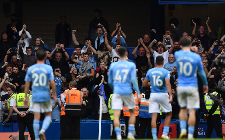 Manchester City's fans react at the final whistle during the English Premier League football match between Chelsea and Manchester City on 25 September 2021. Picture: AFP