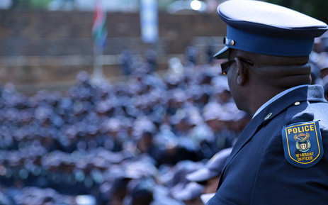 A police officer looks on into the crowd at the commemoration ceremony at the Union Buildings in Pretoria for the almost 60 police officers killed since the start of 2015. Picture: Reinart Toerien/EWN.