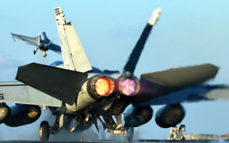FILE: An F/A-18E Super Hornet prepares to take-off from an aircraft carrier. Picture: AFP