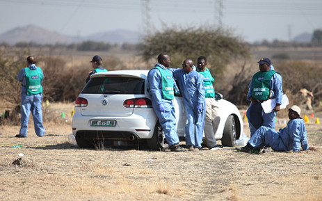 Crime scene investigators on the scene of the Lonmin mine shootings on 16 August 2012. Picture: Taurai Maduna/EWN.