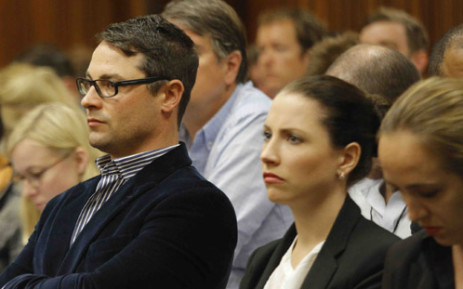 Carl and Aimee Pistorius watch court proceedings at the High Court in Pretoria on 4 March 2014. Picture: Pool.