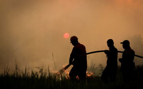 FILE: This picture taken on 22 August 2019 shows Indonesian firefighters battling a forest fire in Ogan Ilir, South Sumatra. Picture: AFP