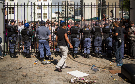 Police block UCT #FeesMustFall protesters outside of Parliament after clashes between officers and protesters broke out. Picture: Anthony Molyneaux/EWN.