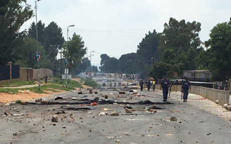 There's a heavy police presence in Zandspruit where community members have embarked on protests over the disconnection of illegal electricity supply in the area. Picture: Masego Rahlaga/EWN.