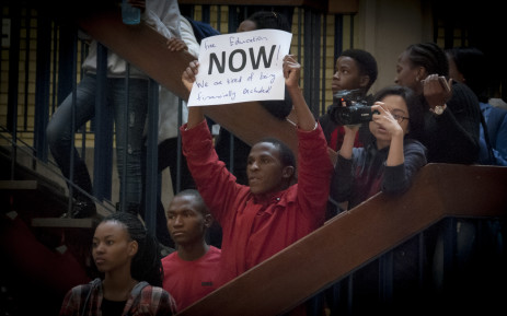 A students holds up a poster at Wits University after the announcement of an 8% increase by Min of Higher Education Nzimande. Picture: Nina Leslie/EWN