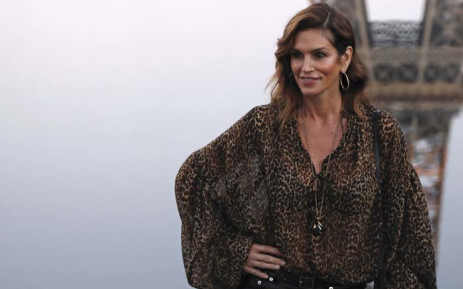 US model Cindy Crawford poses for photographs upon her arrival prior to the Yves Saint Laurent Spring-Summer 2019 Ready-to-Wear collection fashion show in Paris, on 25 September 2018. Picture: AFP