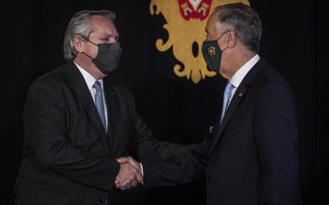 Portuguese President Marcelo Rebelo de Sousa (R) welcomes his Argentinian counterpart Alberto Fernandez at the Belem Palace in Lisbon during his official visit to Portugal on May 9, 2021. Picture: Carlos Costa / AFP.