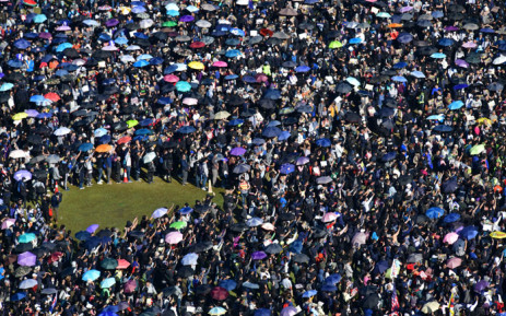 """People gather at Victoria Park for a pro-democracy rally in Hong Kong on 8 December 2019. Hong Kong democracy protesters are hoping for huge crowds December 8 at a rally they have billed as a """"last chance"""" for the city's pro-Beijing leaders in a major test for the six-month-old movement. Picture: AFP"""