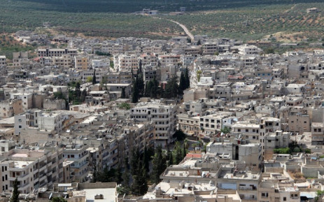 File: A picture taken on 29 May 2015 from the top of a hill shows a general view of the town of Ariha, in the northwestern province of Idlib, a day after the city was seized by a rebel coalition led by al-Qaedas Syria franchise. Picture: AFP.